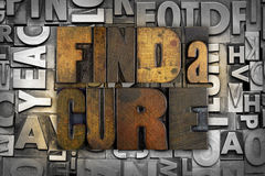 Find a Cure. The words FIND A CURE written in vintage letterpress type Royalty Free Stock Image