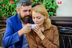 Find and date businessman. Girl dating with businessman. Dating businessman. Couple cuddling cafe terrace. Couple in. Love sit cafe terrace enjoy coffee. Things royalty free stock image