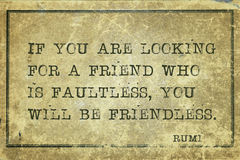 Find friend Rumi. If you are looking for a friend who is faultless - ancient Persian poet and philosopher Rumi quote printed on grunge vintage cardboard Royalty Free Stock Photography