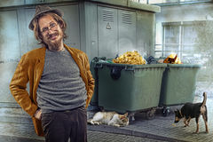 Find a gold in rubbish. Carefree style man finds gold in rubbish container. Backyard background : two trush containers, stray pets Royalty Free Stock Photography