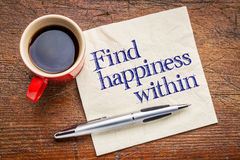 Find happiness within advice. Handwriting on a napkin with cup of coffee against rustic wood background Royalty Free Stock Photography