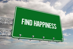 Find happiness against sky. The word find happiness and green billboard sign against sky Royalty Free Stock Photos