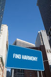 Find harmony against new york. The word find harmony and blue billboard against new york Stock Images