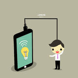 Find information from mobile. Lamp of idea in smartphone and businessman who load idea Stock Photo