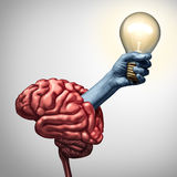 Find Inspiration Concept. As an arm holding an illuminated lightbulb emerging out of a brain as an innovation metaphor for the power of ideas and creative Royalty Free Stock Images