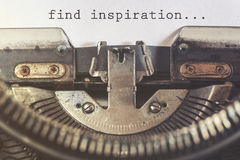 Find inspiration motivational message. Written with a vintage typewriter royalty free stock image