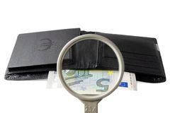 Find investor concept with wallet and magnifier Royalty Free Stock Image