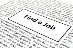 Find a job. In newspaper showing unemployment concept Royalty Free Stock Images