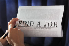 Find a job. Finding a job on a newspaper. searching note: find a Job is not real newspaper Stock Photography