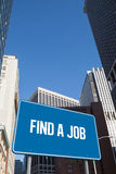 Find a job against new york. The word find a job and blue billboard against new york Royalty Free Stock Photography