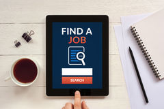 Find a job concept on tablet screen with office objects Royalty Free Stock Photos