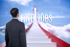 Find jobs against red steps arrow pointing up against sky Royalty Free Stock Photo