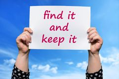 Find it and keep it. Motivational sign woman holding by hand royalty free stock image