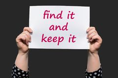 Find it and keep it. Motivational sign woman holding by hand royalty free stock photos