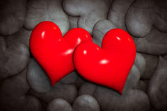 Find love concept. Two red hearts among many black and white ones. Royalty Free Stock Photo