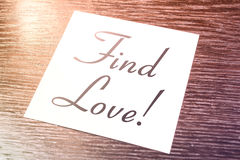 Find Love Reminder On Paper Lying On Wooden Cupboard. A Find Love Reminder On Paper Lying On Wooden Cupboard Royalty Free Stock Photos