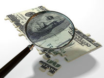 Find money. Magnifying glass and the puzzle of the dollar Stock Photo