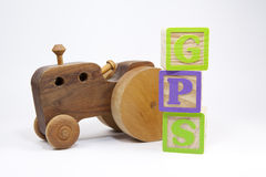 Find my way. Wooden toy blocks and wooden toy car with a GPS signal Stock Photography