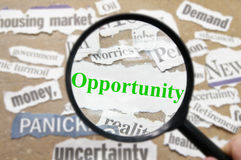 Find opportunity. News headlines and magnifying glass with Opportunity text Royalty Free Stock Photos