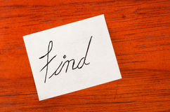 Find - Post it Note on Wood Background Stock Image