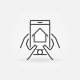 Find real estate via smartphone. Hands holding phone with real estate app concept symbol in thin line style Stock Photography
