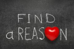 Find a reason chb. Find a reason phrase handwritten on blackboard with heart symbol instead O royalty free stock image