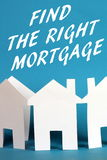 Find The Right Mortgage. The phrase Find The Right Mortgage in white text above a paper chain of house shapes on a blue background royalty free stock photo