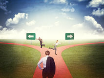 Find the right way. Business people and different way Royalty Free Stock Photo