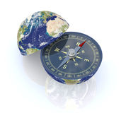 Find the right way. One earth globe divided into two parts, with a compass; concept of travel, but also as metaphor of finding the right way; earth map courtesy Royalty Free Stock Photo