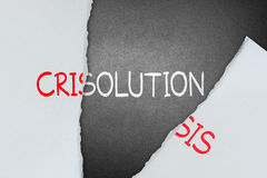 Find solution for crisis. Tear crisis paper to find out solution Stock Image
