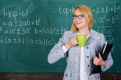 Find time to relax and stay positive. Keep positive attitude to work. Woman with tea cup and document folder chalkboard. Background. Time to relax. Teacher royalty free stock photos