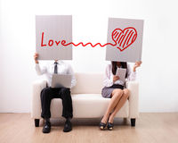 Find ture love on internet. Men and women using computer and digital tablet on sofa Royalty Free Stock Image
