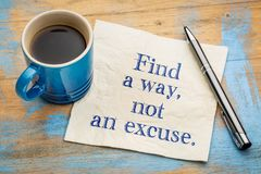 Find a way, not an excuse. Inspirational handwriting on a napkin with a cup of espresso coffee royalty free stock image