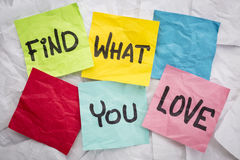 Find what you love advice. Find what you love - reminder or advice handwritten on colorful sticky notes Stock Photography