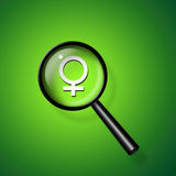 Find woman. Female Symbol under magnifying glass Stock Images