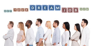 Find your dream job!. Side view of confident diverse group of people in smart casual wear looking away while standing in a row and against white background Stock Image