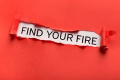 Find your fire inscription showing up behind red torn paper. Find your fire motivation quote written on white background behind ripped red paper. Creativity stock images