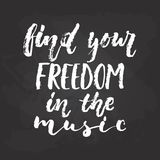Find your freedom in the music - hand drawn Musical lettering phrase isolated on the black chalkboard background. Fun. Brush chalk vector quote for banners Stock Photos