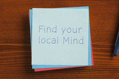 Find your local Mind written on a note Stock Photo