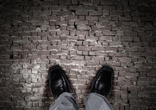 Find your own way. Top view of businessman legs choosing his way Stock Images