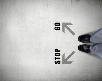 Find your own way. Top view of businessman legs choosing his way Stock Photo