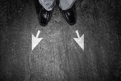 Find your own way. Top view of businessman legs choosing his way Royalty Free Stock Photography