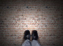 Find your own way. Top view of businessman legs choosing his way Royalty Free Stock Photo