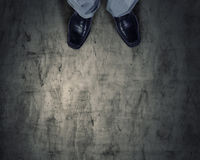 Find your own way. Top view of businessman legs choosing his way Stock Image