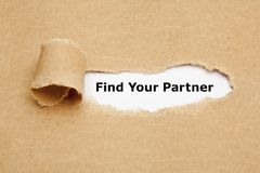 Find Your Partner Behind Torn Paper. Text Find Your Partner appearing behind ripped brown paper Stock Photography