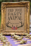 Find Your Party Animal Sign. Find Your Party Animal frame with seating chart animals and rustic theme Royalty Free Stock Photos