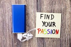 Find your Passion handwritten on a sticky white color note paper in different colors. Power bank of blue color with White cable an. Find your Passion handwritten stock photo