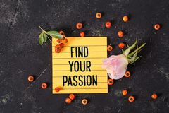 Find your passion text in memo. With rose and Hawthorn on dark grunge background, motivation concept royalty free stock photo