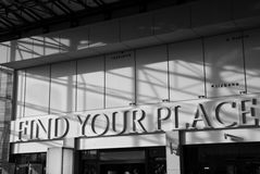 Find your place text on the wall in gallery Royalty Free Stock Images