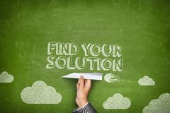Find your solution concept. On green blackboard with businessman hand holding paper plane Royalty Free Stock Photo
